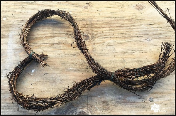 soak grapevine wreath to hold the new shape