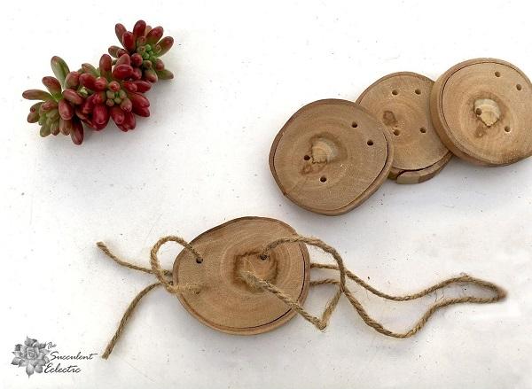 adding jute hangers to wood slice Christmas ornaments