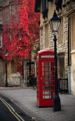 red telephone booth against brown wall backdrop via tumblr