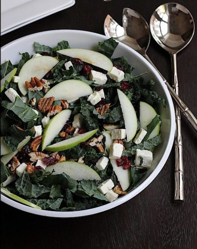 kale salad with walnuts, cranberries, and apples via savor home