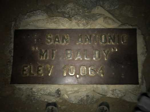 Photo of the plaque at the top of Mt. Baldy Hike.