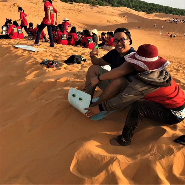 Sledding down sand dunes Budget Breakdown Solo Travel in South Vietnam
