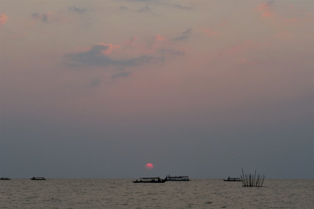 Sunset at Tonle Sap Budget Breakdown How To Spend Less Than $50 Per Day in Cambodia