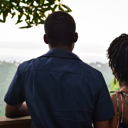 man and woman overlooking hilly terrain