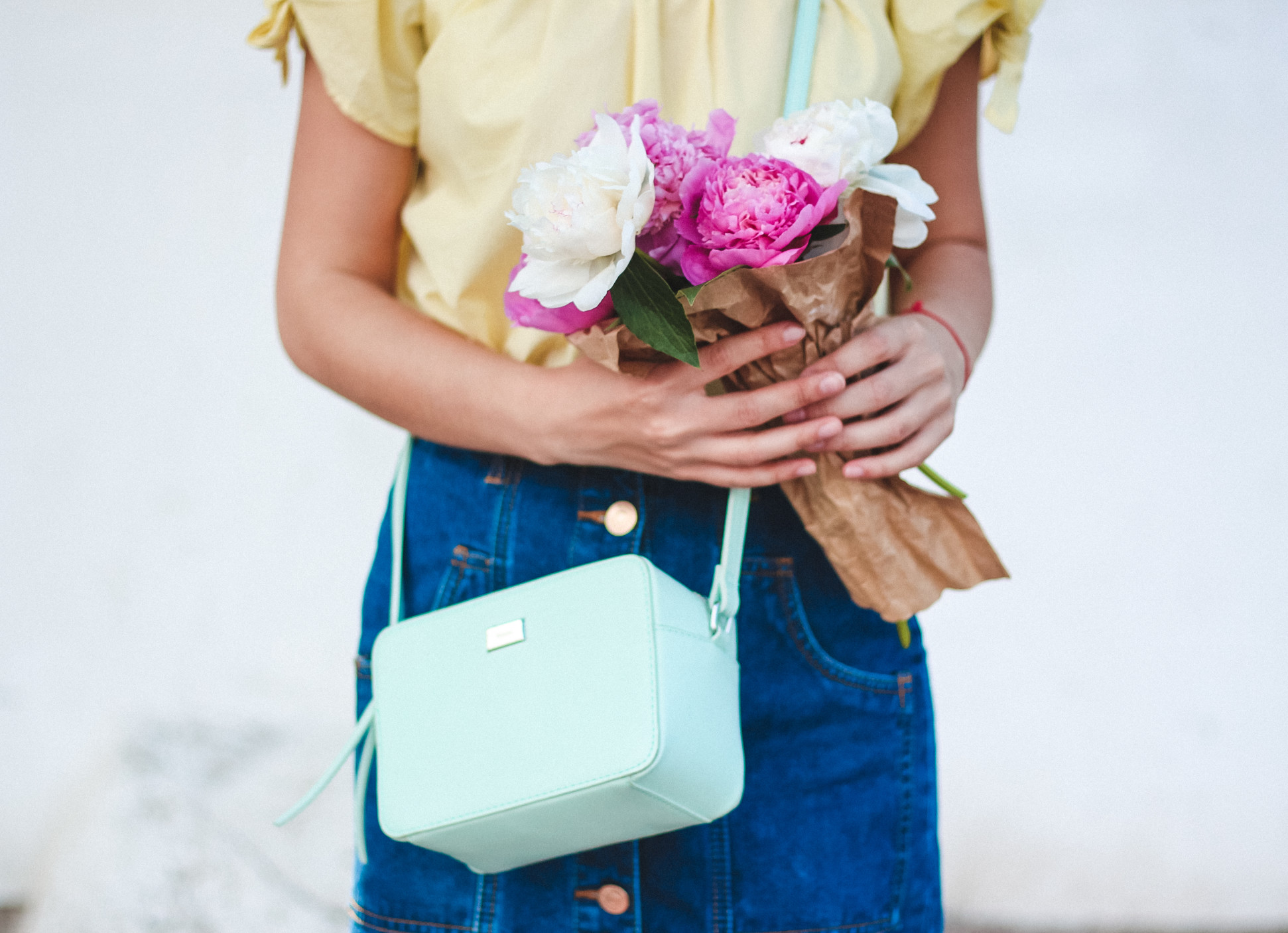 a-girl-with-a-bouquet-with-peonies