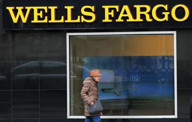 Wells Fargo shareholders re-elected to board despite criticism over scandal