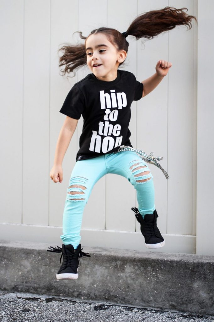 brand rep jumping, wearing her favorite small shop clothing