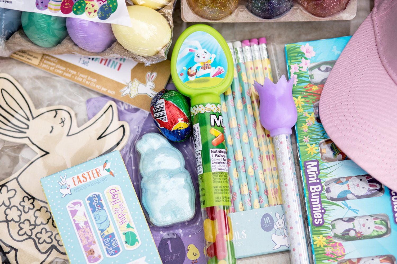 Easter pencils, band-aids, chocolate bunnies and egg shaped chalk are just a few cheap Easter basket stuffers