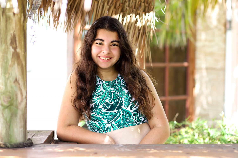 Beautiful girl wearing her SwimZip halter swimwear