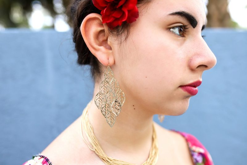 close up of teenage girl wearing large earrings