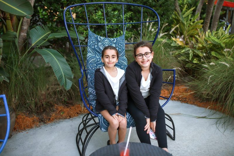 sisters sitting on a chair