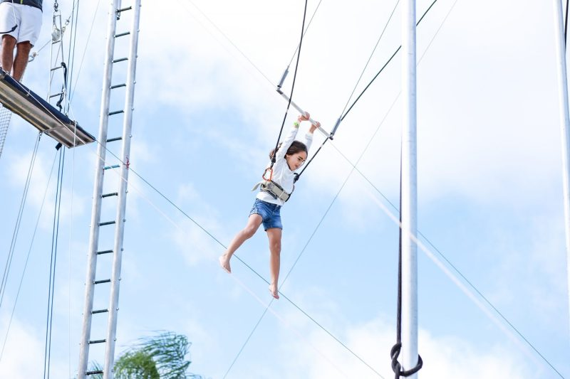 little girl on the trapeze