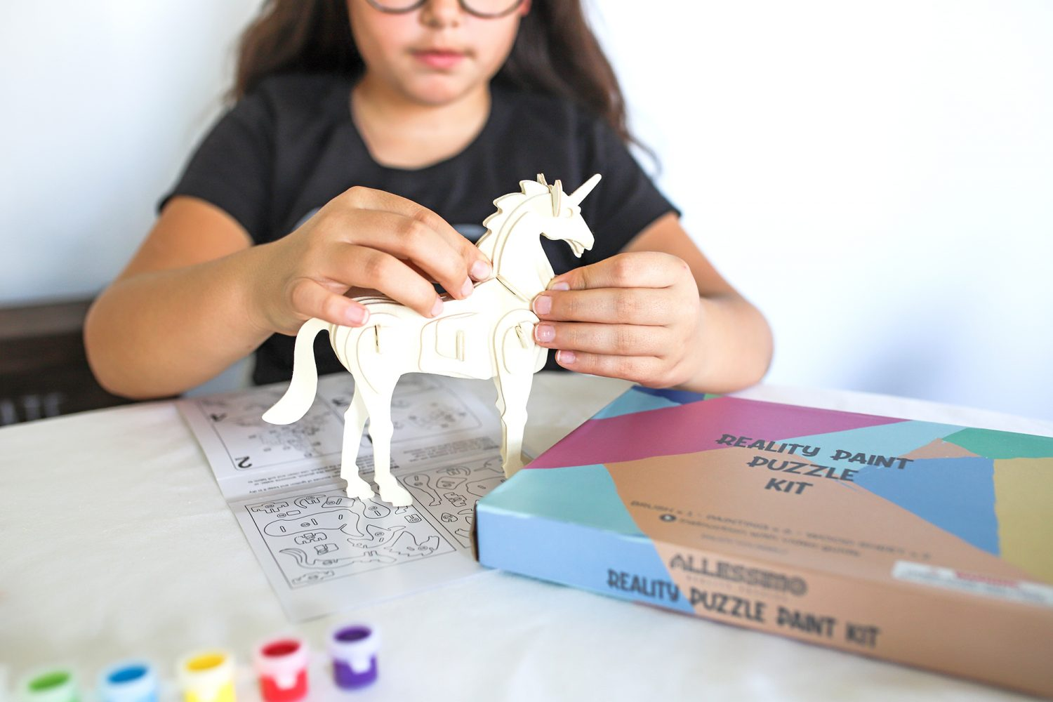 putting together a 3d unicorn puzzle
