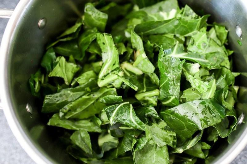 chopped collard greens in a pot