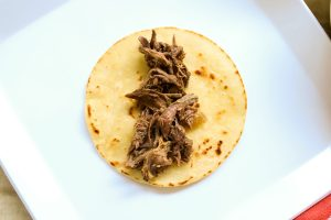 Corn tortilla with meat on a plate