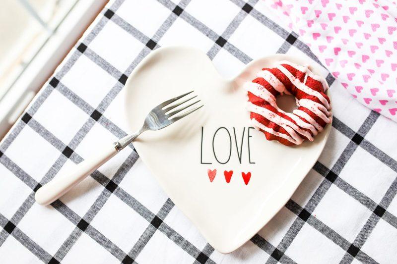 red velvet donut on a rae dunn love plate