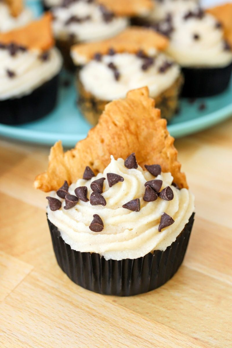 cinnamon and chocolate chip cupcake topped with mascarpone frosting
