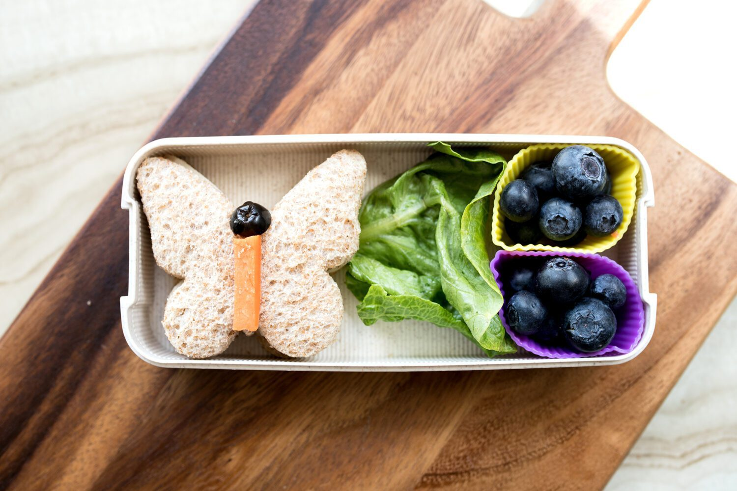 butterfly shaped sandwich and blueberries