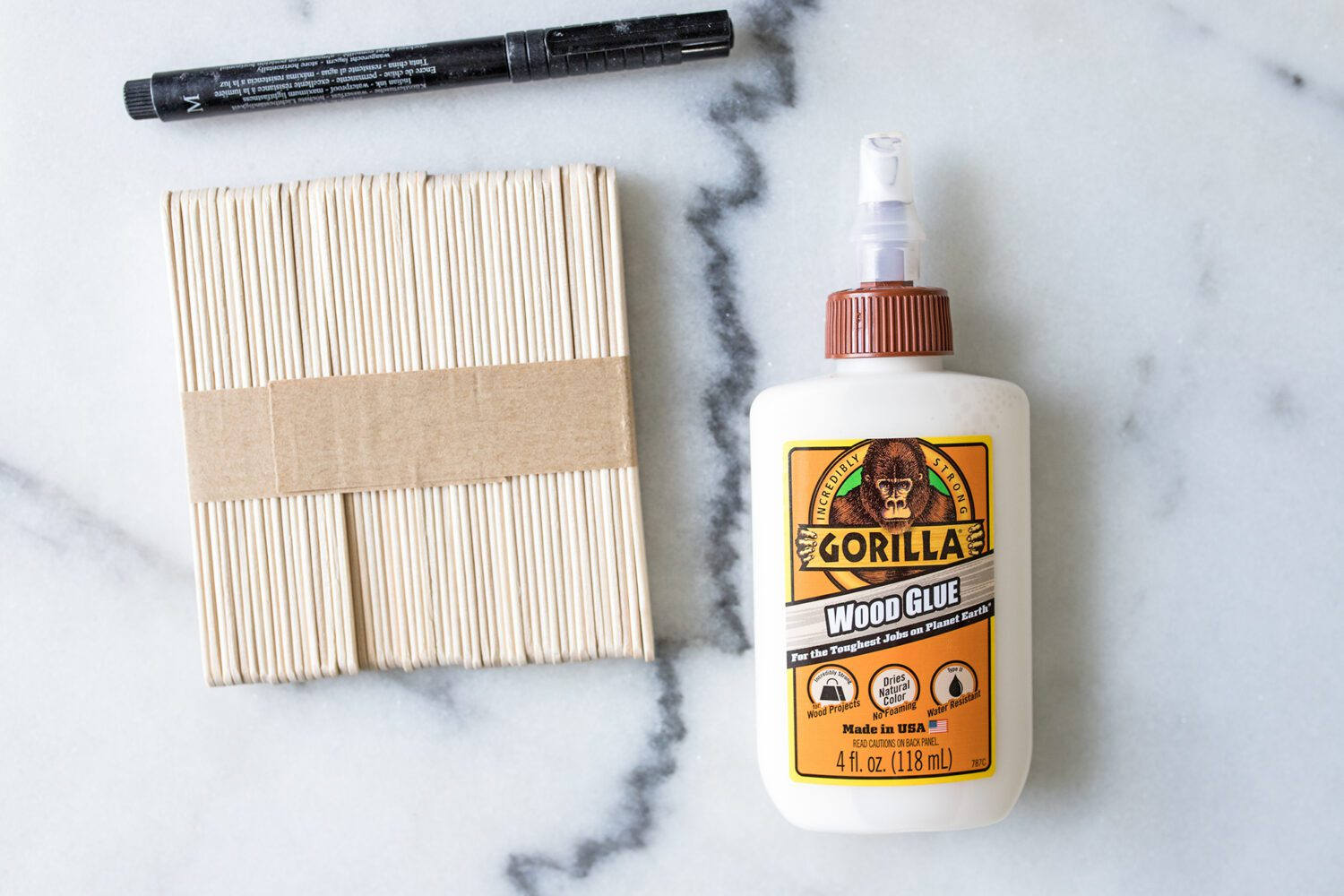 marker, popsicle sticks and wood glue