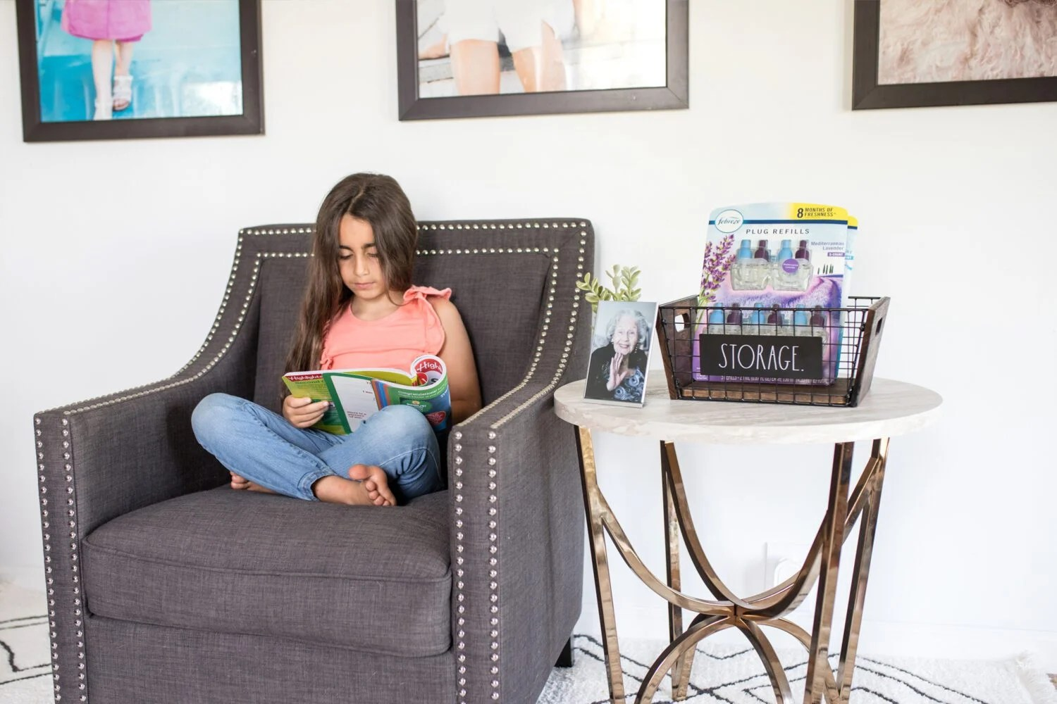 girl sitting on a chair in her living room