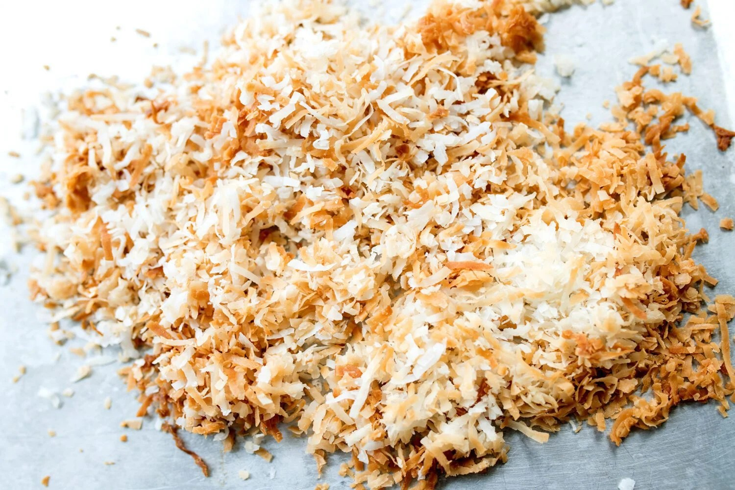 toasted coconut on a baking sheet