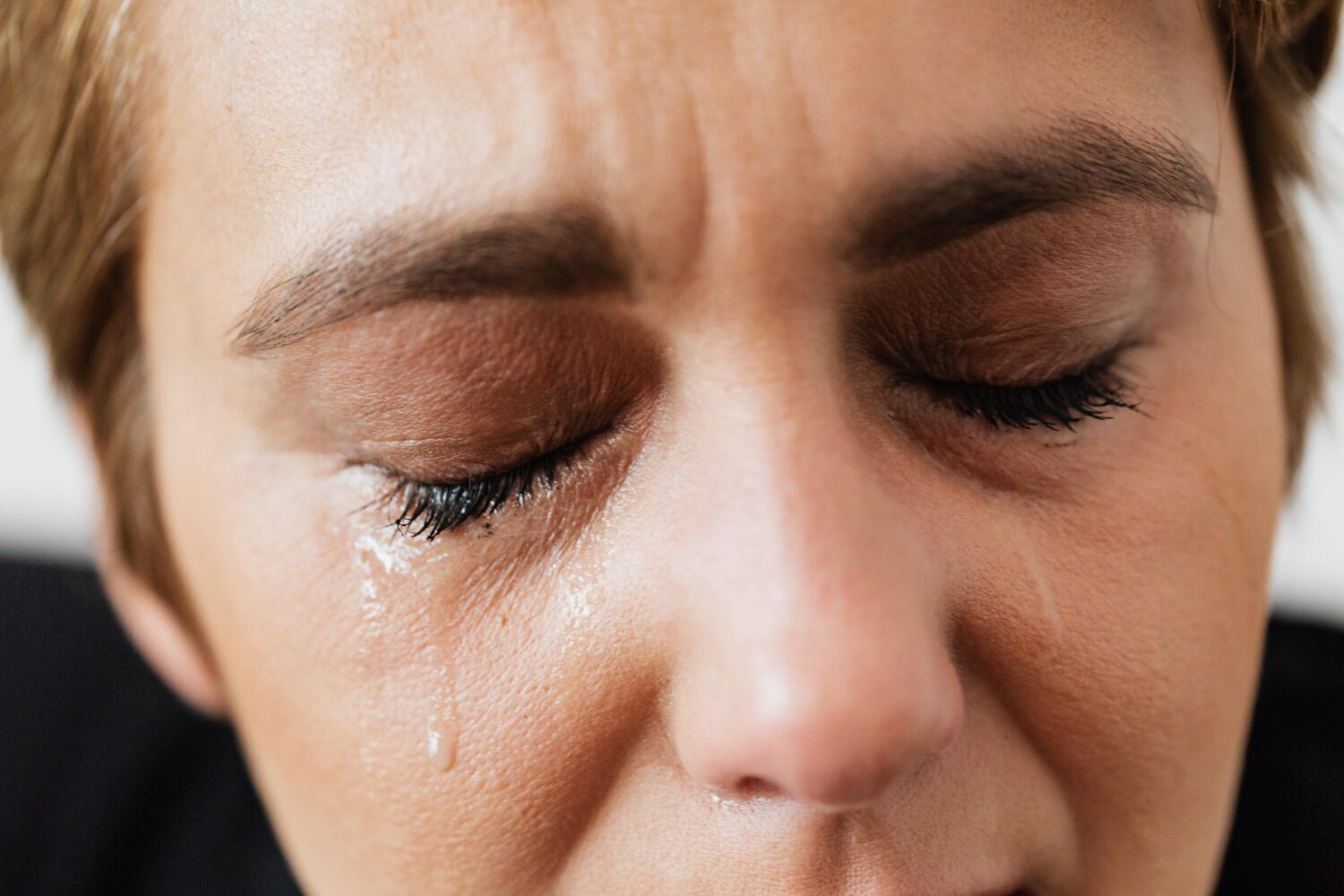 Tears on face of woman with agoraphobia
