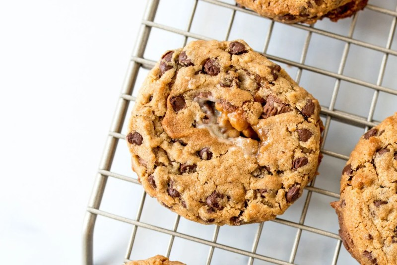 close up of a peanut butter chocolate chip snickers cookie