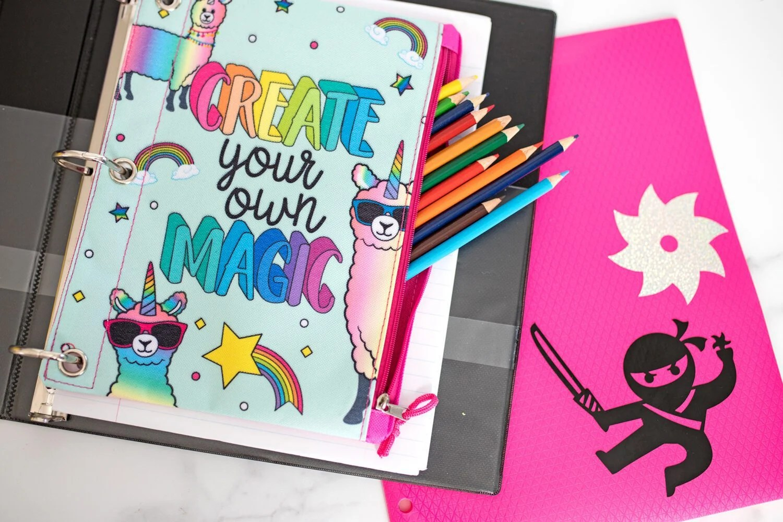 school supplies and a folder created with cricut joy