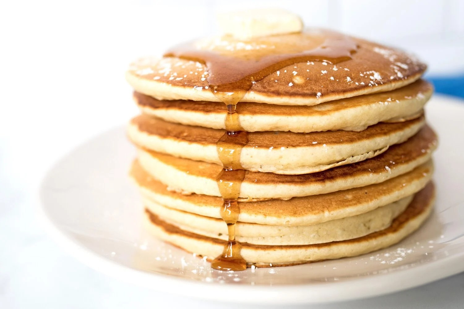 stack of pancakes with maple syrup