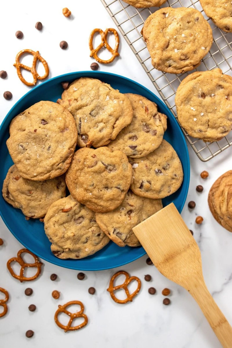 plate full of homemade cookies with pretzels and chocolate chips