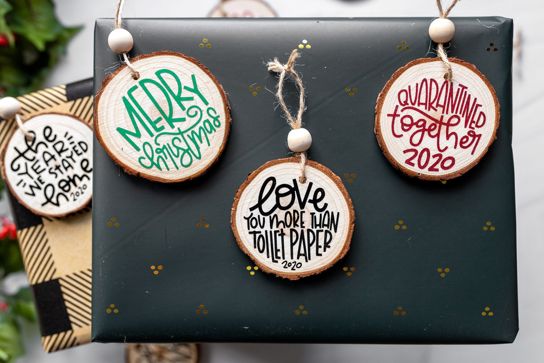 diy rustic wood slice ornaments on top of a present