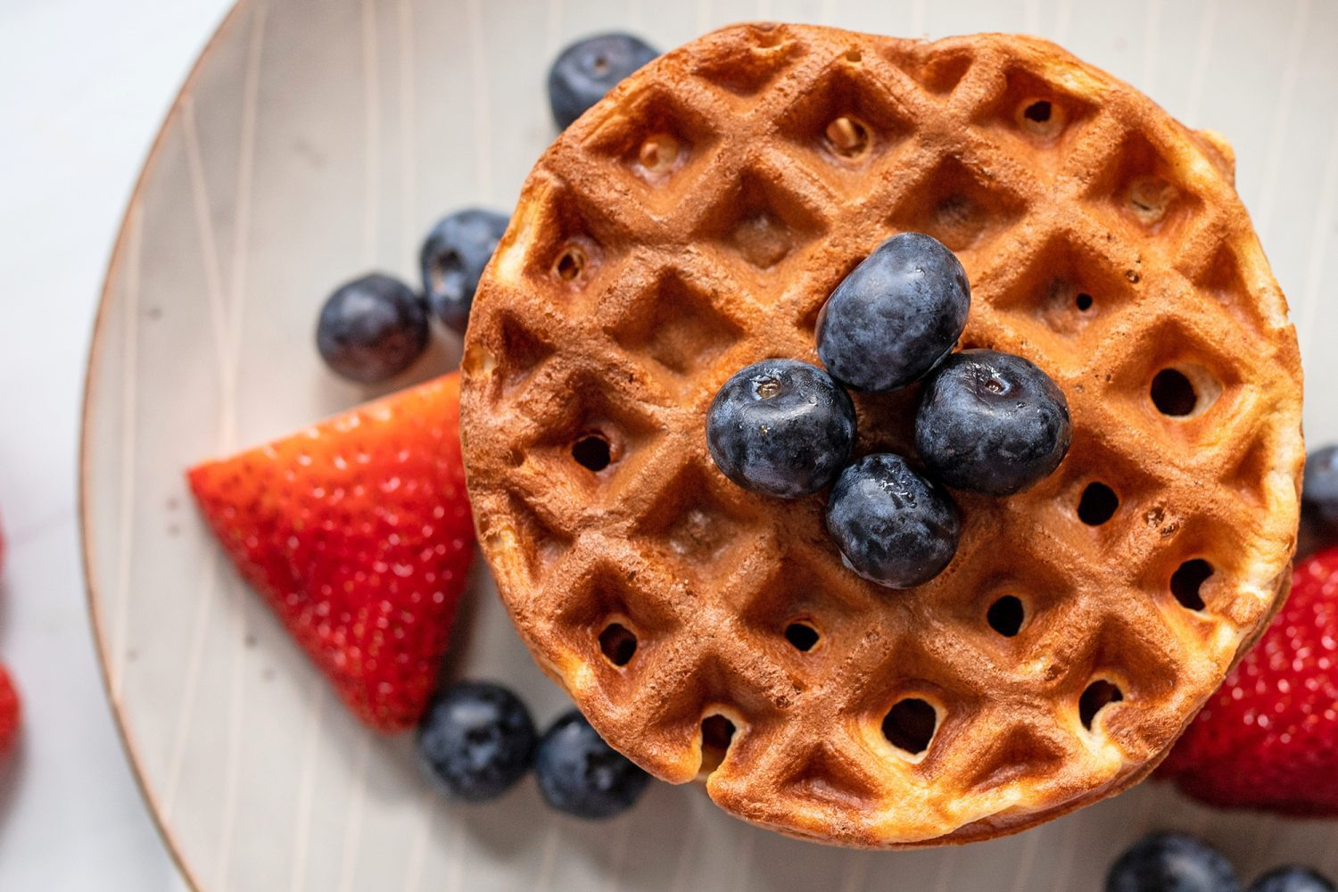 aerial view of a plate of waffles and berries