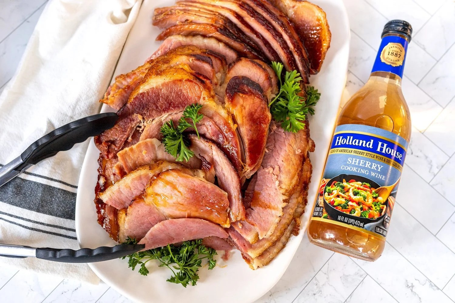 bottle of Holland House sherry wine next to sliced ham