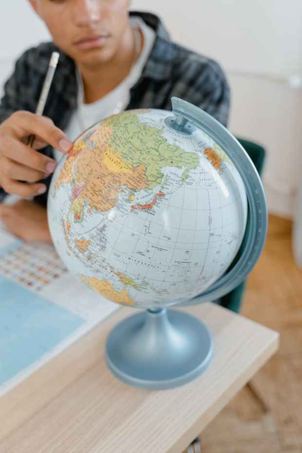 close up photo of a student studying the world map