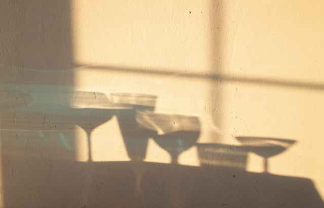 shadows of glasses on wall