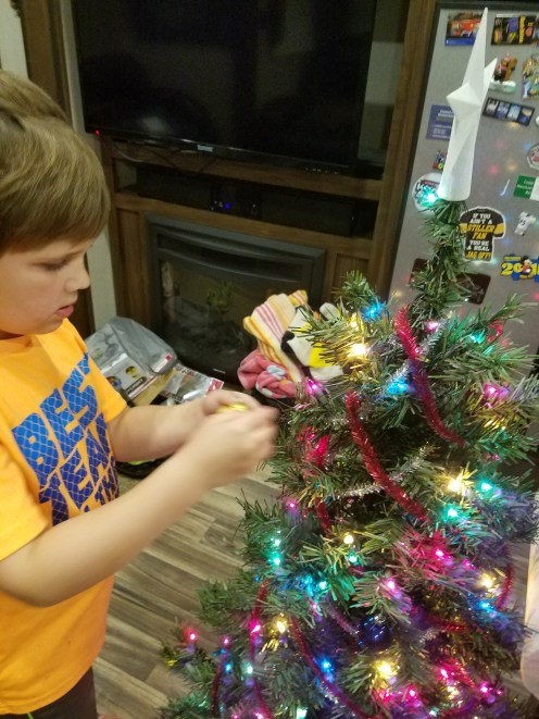 Cameron decorating the tree