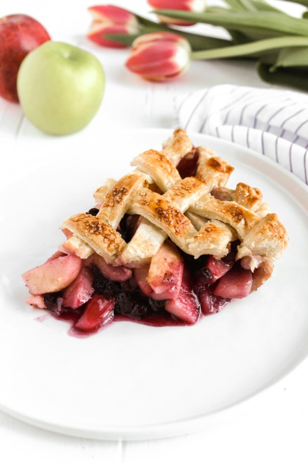 Slice of blueberry apple pie on a plate