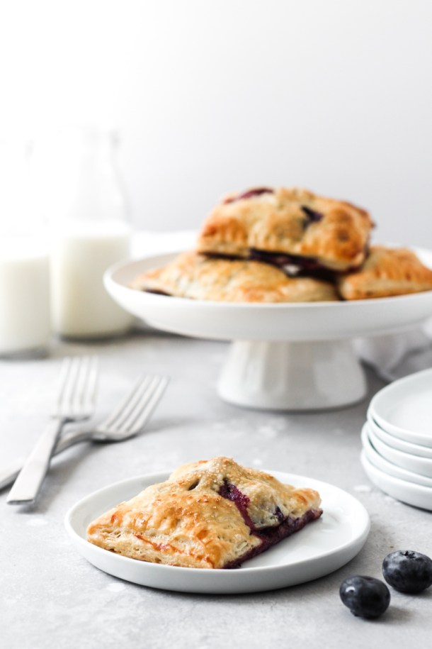 Blueberry Hand Pies on dish and cake stand