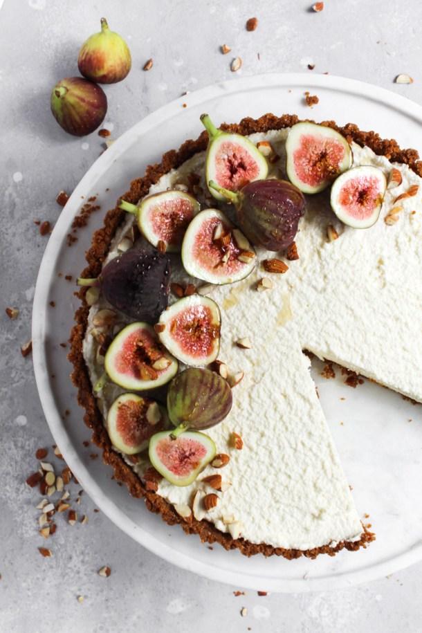 No-bake honey mascarpone fig tart overhead shot with one slice missing.