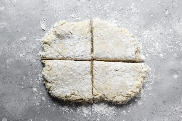 Homemade cream biscuit dough cut in four.
