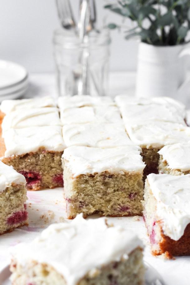 Sliced pasberry sheet cake with lemon mascarpone frosting.