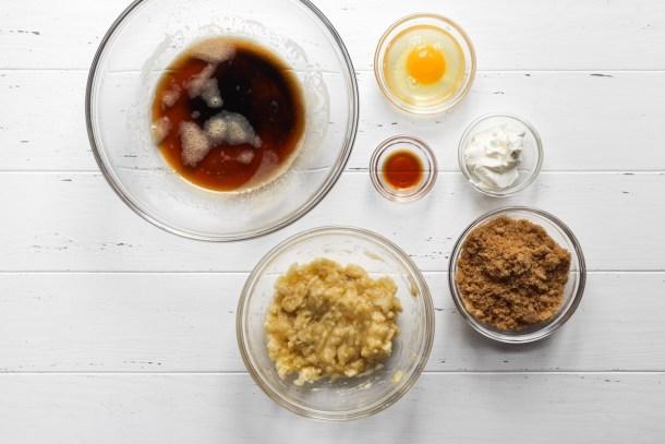 Brown butter, banana, egg, vanilla, sour cream, and brown sugar for banana bread cookies.