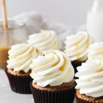 Sweet potato cupcakes with salted maple caramel cream cheese frosting and a caramel drizzle.