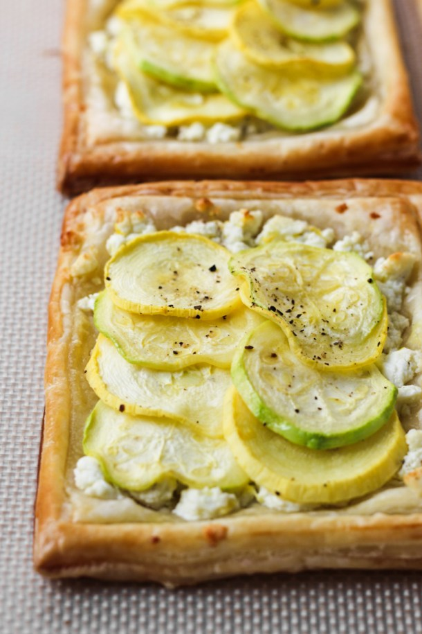 Baked puff pastry with feta, zucchini and yellow squash tarts.