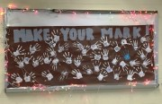 "Participants in the #StealASmile week ""made their mark"" on a poster full of hand prints to symbolize their dedication to winter service."