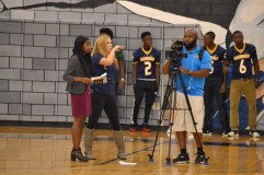 WACH Fox 57's Courtney King (center) and her crew prepare for their broadcast of the pep rally on the station's morning program.