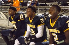 Juniors Tyski Livingston and Myles Adams and Senior Kenyon Williams take a seat after a great play. File photo.