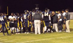 The team gathers in a huddle on offense. File photo.