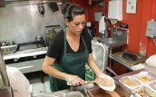 Rosy Araujo, Mama's Kitchen head cook, prepares a bean and cheese taco for a to-go order. BRIANNA RODRIGUE / THE TACOIST