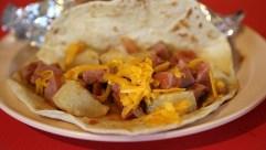 Taco Delicioso (sausage, potato and cheese in a ranchero sauce)